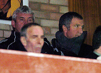 Photo: Leigh Quinnell.<br /> Cheltenham Town v Colchester United. LDV Vans Trophy.<br /> 24/01/2006. Newcastle manager Graham Souness watches the match from the directors box.