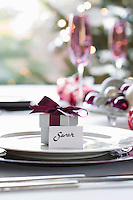 Small gift box with name tag on dining table
