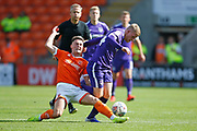 Andy Cannon of Portsmouth is tackled by Jordan Thompson of Blackpool during the EFL Sky Bet League 1 match between Blackpool and Portsmouth at Bloomfield Road, Blackpool, England on 31 August 2019.