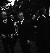 Funeral of Eamon DeValera.   (J72)..1975..02.09.1975..09.02.1975..2nd September 1975..Today saw the funeral of Eamon DeValera. He was laid to rest beside his wife Sinead in Glasnevin Cemetery,Dublin. Dignitries from all around the world attended at the funeral...Image of Mr Charles Haughey and Mr Patrick Hillery who were among the mourners at the funeral of Eamon DeValera.