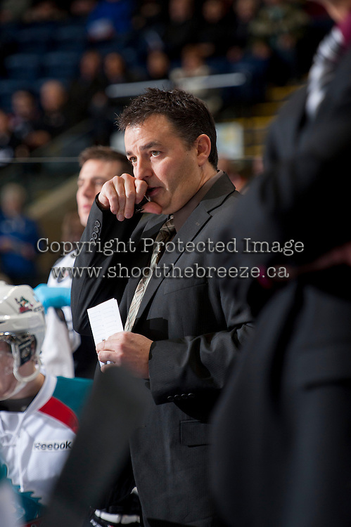 KELOWNA, CANADA - JANUARY 26: Dan Lambert, coach of the Kelowna Rockets stands on the bench opposite the Prince Albert Raiders at the Kelowna Rockets on January 26, 2013 at Prospera Place in Kelowna, British Columbia, Canada (Photo by Marissa Baecker/Shoot the Breeze) *** Local Caption ***