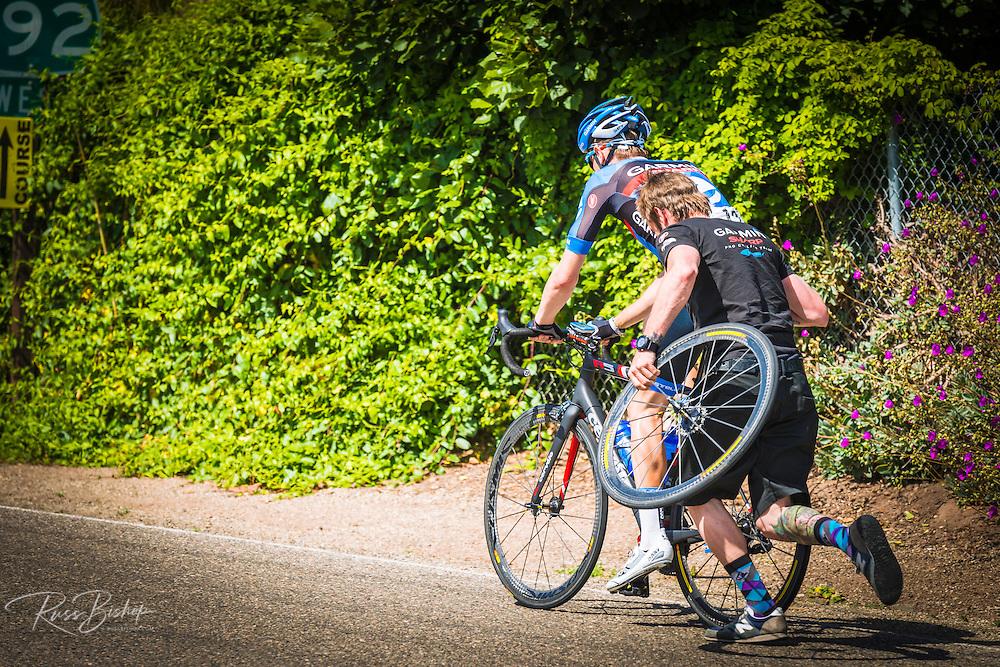 Professional cyclist getting support at the Amgen Tour of California, Santa Barbara, California USA