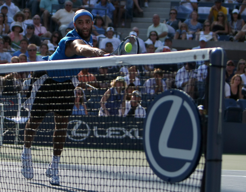 James Blake of the US hits a backhand return at the net to Tommy Haas of Germany during their fourth round match on the eighth day of the 2007 US Open tennis tournament in Flushing Meadows, New York, USA, 03 September 2007.