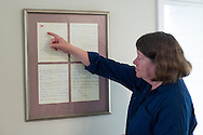 10 June 2015 Point Pleasant Beach USA/ Joan Barry explains the framed letter on her wall. The letter was to be the last that  Father Thomas Roussel Davids Byles  would ever write. Father Thomas Roussel Davids Byles(26 February 1870 – 15 April 1912) was an English Catholic priest who famously remained on board the RMS Titanic as she was sinking after colliding with an iceberg, hearing confessions and giving absolution. /  Michael Glenn For the Monitor