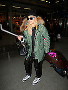 23.JANUARY.2013. LONDON<br /> <br /> RITA ORA ARRIVING BACK AT ST.PANCRAS INTERNATIONAL AFTER ARRIVING BACK ON THE EUROSTAR FROM PARIS.<br /> <br /> BYLINE: EDBIMAGEARCHIVE.CO.UK<br /> <br /> *THIS IMAGE IS STRICTLY FOR UK NEWSPAPERS AND MAGAZINES ONLY*<br /> *FOR WORLD WIDE SALES AND WEB USE PLEASE CONTACT EDBIMAGEARCHIVE - 0208 954 5968*
