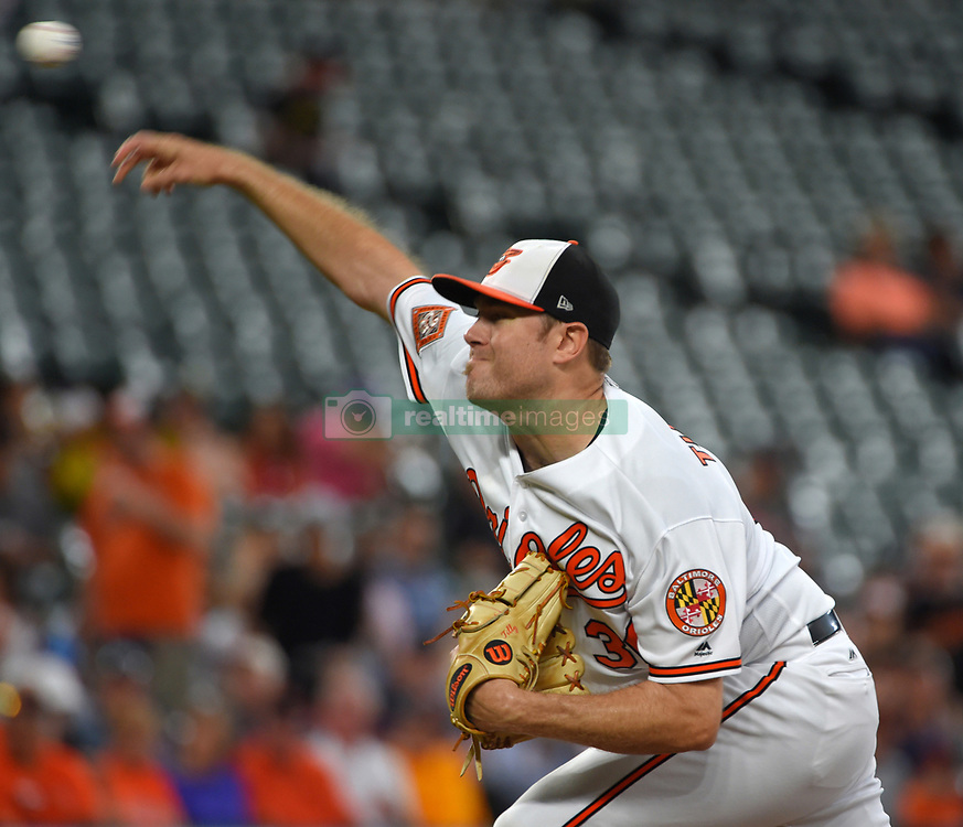 August 3, 2017 - Baltimore, MD, USA - The Baltimore Orioles' Chris Tillman pitches in the first inning against the Detroit Tigers at Oriole Park at Camden Yards in Baltimore on Thursday, Aug. 3, 2017. (Credit Image: © Lloyd Fox/TNS via ZUMA Wire)