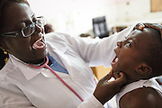 Dr. Denise Mobio examines Junior Karampire, 5, who suffers from recurring ear infections, at the Koumassi General Hospital in Abidjan, Cote d'Ivoire on Friday July 19, 2013.