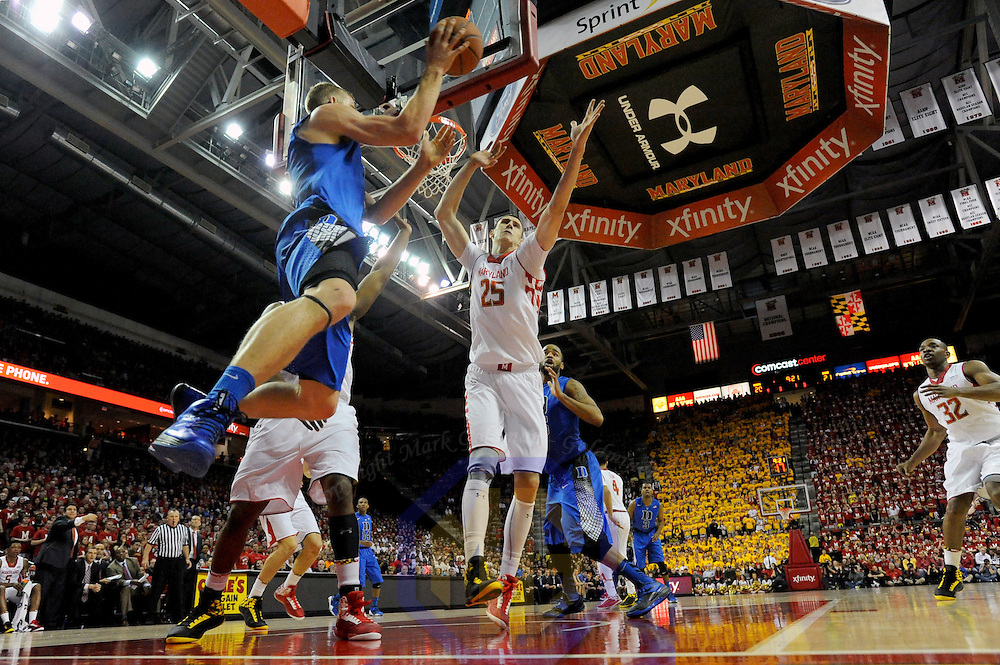 16 February 2013:   Duke Blue Devils forward Mason Plumlee (5) in action against Maryland Terrapins center Alex Len (25) at the Comcast Center in College Park, MD. where the Maryland Terrapins upset the second ranked Duke Blue Devils, 83-81.