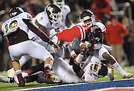 Mississippi wide receiver Vince Sanders (10) scores on a pass play as Mississippi State linebacker Cameron Lawrence (10), Mississippi State defensive back Jay Hughes (30), Mississippi State defensive back Nickoe Whitley (5), and Mississippi State linebacker Benardrick McKinney (50) defend at Vaught Hemingway Stadium in Oxford, Miss. on Saturday, November 24, 2012. Mississippi won 41-24. (AP Photo/Oxford Eagle, Bruce Newman).
