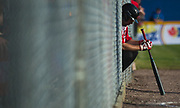 A Canadian batter waits to enter the field during a game between Canada and Dominican Republic during the 2017 Men's World Softball Championship.