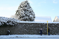 Waiting for a bus in the snow in Dublin Ireland during the cold snap in November 2010