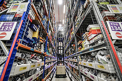Embargoed to 0001 Friday November 16 A high lift platform raises up so a worker can pick items to be shipped at Amazon's fulfillment centre in Swansea, in the run up to Black Friday.