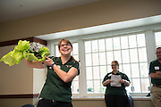 Jennie Daniels holds up her gift at the Campus Communicator Network Expo in Nelson Commons on Wednesday, May 11, 2016. © Ohio University / Photo by Kaitlin Owens