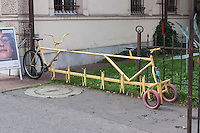 Bicycle parking made from a large bike seen in Krakow Poland