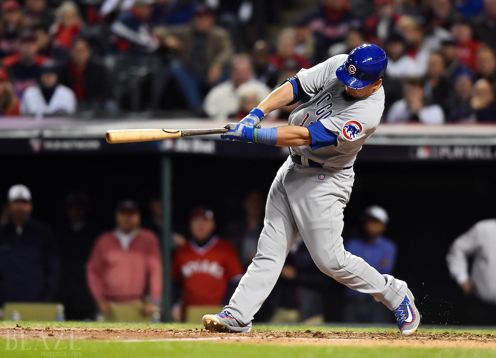 Oct 25, 2016; Cleveland, OH, USA; Chicago Cubs player Kyle Schwarber (12) hits a double against the Cleveland Indians in the fourth inning in game one of the 2016 World Series at Progressive Field. Mandatory Credit: Ken Blaze-USA TODAY Sports