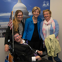 U.S. Senator Elizabeth Warren, Democrat from Massachusetts, poses for a photo with members of Goodwill Industries in her Washington, DC office on April 15, 2015