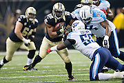 NEW ORLEANS, LA - NOVEMBER 8:  Mark Ingram #22 of the New Orleans Saints is hit by Sammie Hill #94 and Zach Brown #55 of the Tennessee Titans at Mercedes-Benz Superdome on November 8, 2015 in New Orleans, Louisiana.  The Titans defeated the Saints in overtime 34-28.  (Photo by Wesley Hitt/Getty Images) *** Local Caption *** Mark Ingram; Zach Brown; Sammie Hill