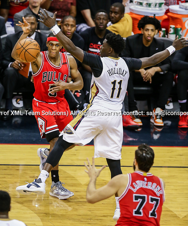 NEW ORLEANS, LA - APRIL 02: Chicago Bulls guard Rajon Rondo (9) passes the ball to center Joffrey Lauvergne (77) against New Orleans Pelicans guard Jrue Holiday (11) during the game between the New Orleans Pelicans and the against the Chicago Bulls on April 2, 2017, at Smoothie King Center in New Orleans, LA.  Bull won 117-110. (Photo by Stephen Lew/Icon Sportswire)