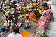 "Mexicans visiting their dead relatives, lighting candles, lighting incense and decorating their graves for the Day of the Dead festival in San Andre de Mixquic shot as part of the Sony RX100 III ""Celebrate The Streets"" series."