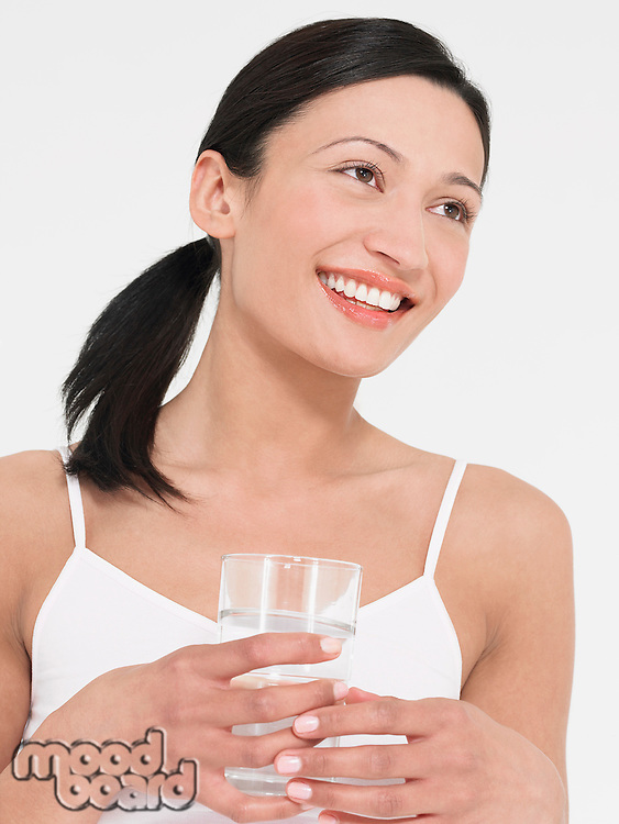 Young Woman in underwear Drinking glass of Water