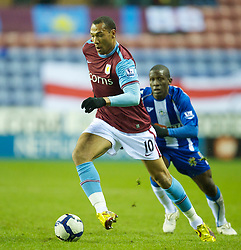 WIGAN, ENGLAND - Tuesday, March 16, 2010: Aston Villa's John Carew in action against Wigan Athletic during the Premiership match at the DW Stadium. (Photo by David Rawcliffe/Propaganda)
