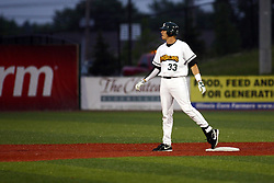 09 June 2011: Jeff Dunbar tags up at second base  during a game between the Lake Erie Crushers and the Normal Cornbelters at the Corn Crib in Normal Illinois.