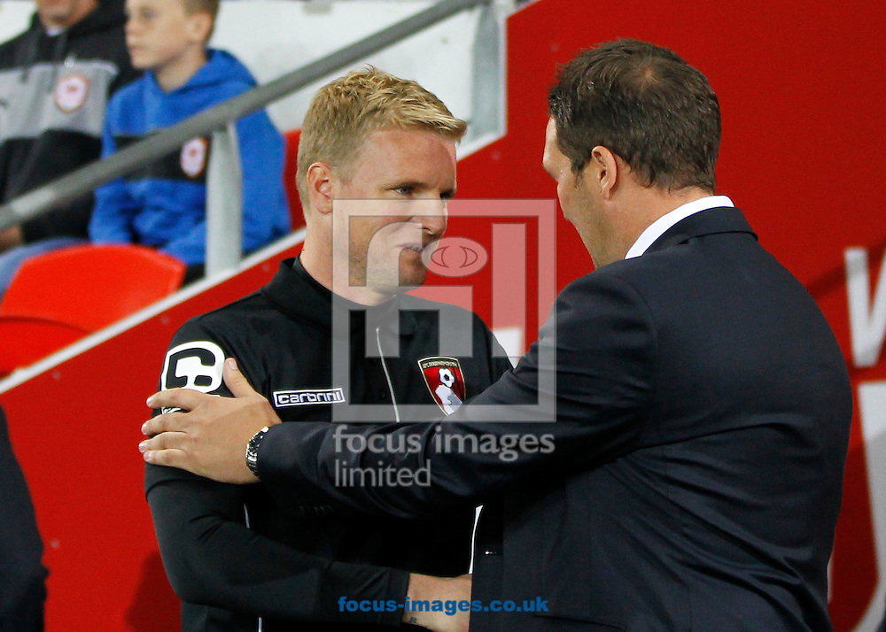 Scott Young, Caretaker Manager of Cardiff City and Eddie Howe of Bournemouth during the Sky Bet Championship match at the Cardiff City Stadium, Cardiff<br /> Picture by Mike  Griffiths/Focus Images Ltd +44 7766 223933<br /> 23/09/2014