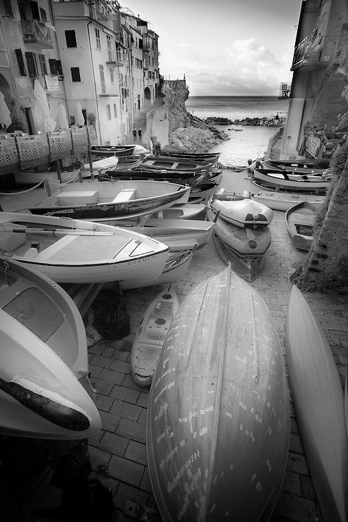Black and white photo of fishing boats in Riomaggiore, Cinque terra, Italy