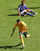 FIFA World Cup 2006 A dejected Yuichi Komano of Japan as Tim Cahill of Australia goes off to celebrate after scoring to make it 1-1