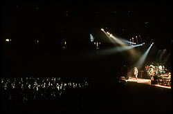 The Grateful Dead in Concert at the Brendan Bryne Arena, East Rutherford NJ, on March 30th 1988. Oblique View just above Stage Level, Stage Left showing Lights into Audience.