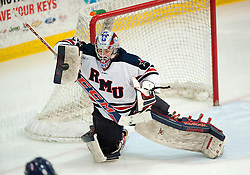 March 11 2016: Robert Morris Colonials goalie Terry Shafer (1) makes a save with his blocker during the second period in game one of the Atlantic Hockey quarterfinals series between the Bentley Falcons and the Robert Morris Colonials at the 84 Lumber Arena in Neville Island, Pennsylvania (Photo by Justin Berl)