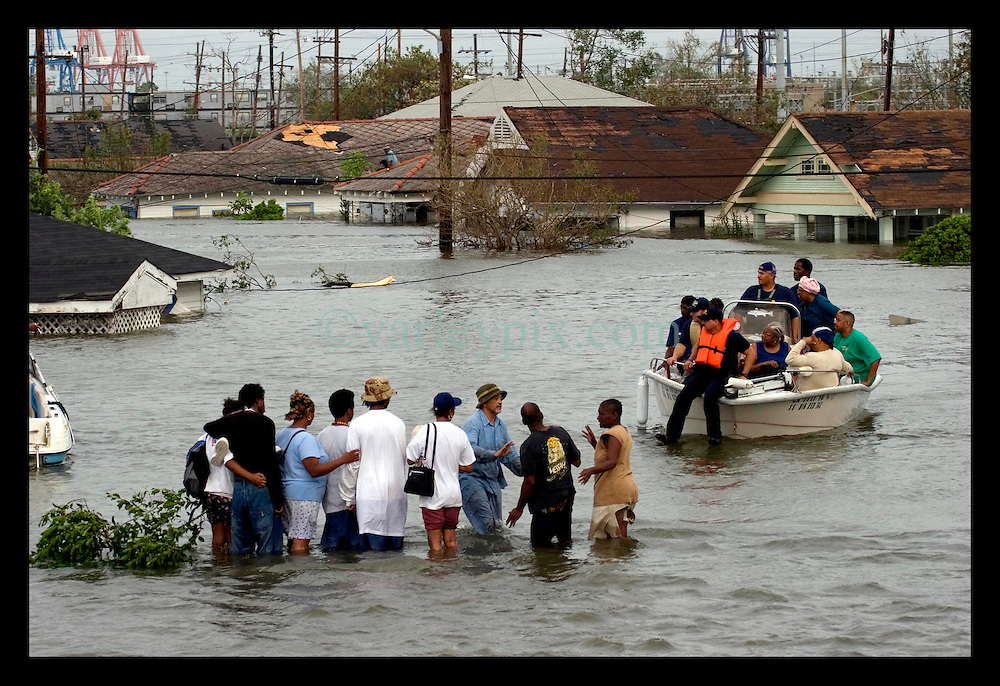 29th August, 2005. Hurricane Katrina hits New Orleans, Louisiana. Rescuers collect stranded residents of the lower 9th ward after it disappeared under water.
