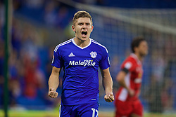 CARDIFF, WALES - Wednesday, August 17, 2016: Cardiff City's Declan John celebrates the first goal against Blackburn Rovers after his shot led to an own-goal during the Football League Championship match at Cardiff City Stadium. (Pic by David Rawcliffe/Propaganda)