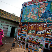 A truck in Jaipur features a depiction of the Indian god Krishna, and his wife Radha.