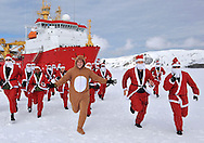 """SANTAS ANTARTIC RUN FOR KATE'S CHARITY.After breaking ice for the first time this Austral Summer 20 members of HMS Protector ship's company took to the ice dressed as Santa Claus in support of the shipi's affiliated charity, East Anglian Children's Hospice..Catherine, Duchess of Cambridge is the Royal Patron of the charity having visited the Treehouse in Ipswich in March 2012, where she made a first public speech..The Santa run was conducted on ice in the waters surrounding Deception Island, a dormant,  water-filled caldera volcano, one of only two in the world. .Breaking through a sheet of snow covered ice before coming to a planned stop, HMS Protector, the Royal Navy's 5,000 tonne Ice Patrol Ship took position and disembarked her personnel to test the ice conditions and drill ice core samples to ensure the ice was safe..East Anglian Children's Hospice conducts nine Santa runs across Essex and East Anglia throughout the festive period, raising thousands of pounds for the charity_18/12/2012.Picture Shows: HMS Protector's Santas spell out EACH whilst on the ice..Mandatory Credit Photo: ©A Hoare/NEWSPIX INTERNATIONAL..**ALL FEES PAYABLE TO: """"NEWSPIX INTERNATIONAL""""**..IMMEDIATE CONFIRMATION OF USAGE REQUIRED:.Newspix International, 31 Chinnery Hill, Bishop's Stortford, ENGLAND CM23 3PS.Tel:+441279 324672  ; Fax: +441279656877.Mobile:  07775681153.e-mail: info@newspixinternational.co.uk"""