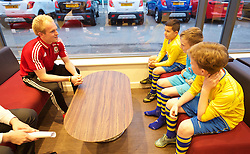 CARDIFF, WALES - Wednesday, November 11, 2015: Wales' Jonathan Williams is interviewed by three local school children as part of a Vauxhall competition. (Pic by David Rawcliffe/Propaganda)