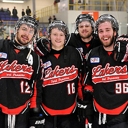 """122FORT FRANCES, ON - May 1, 2015 : Central Canadian Junior """"A"""" Championship, game action between the Fort Frances Lakers and the Toronto Patriots, semi-final game of the Dudley Hewitt Cup.  Matt Vela #12, Lucas DeBenedet #16, Bowen Alcock #15 and Bryson Jasper #96 of the Fort Frances Lakers celebrate their victory.<br /> (Photo by Clint Bruyere / OJHL Images)"""