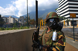National Guardsmen awaits order as riots continued in Caracas between the Guard and anti-government protestors. The country is awaiting a preliminary decision on the validity of signatures seeking a recall referendum.  It is expected that hundreds of thousands of signatures will have to go to a review process that the opposition will refuse to submit to.