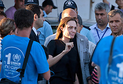 © licensed to London News Pictures. HATAY/ TURKEY. PICTURE DATED. 17/06/2011. UNHCR Goodwill Ambassador, Angelina Jolie, meets with Syrian refugees at the Turkish Red Crescent camp in the Yayladagi district of the Turkish city of Hatay, two kilometers from the Syrian border, on June 17, 2011. More than 9000 Syrians have now fled the violence of Syria's 3-month anti-regime uprising against the rule of President Bashar al-Assad and crossed into Turkey in the past ten days. Please see special instructions for usage rates. Photo credit should read TOLGA AKMEN/LNP