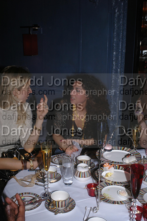 Nathalie Press and Nargess Gharani. 'Pret-a-Portea'M.A.C. launches High Tea collection with British fashion designers. Berkeley Hotel. 17 January 2004. ONE TIME USE ONLY - DO NOT ARCHIVE  © Copyright Photograph by Dafydd Jones 66 Stockwell Park Rd. London SW9 0DA Tel 020 7733 0108 www.dafjones.com