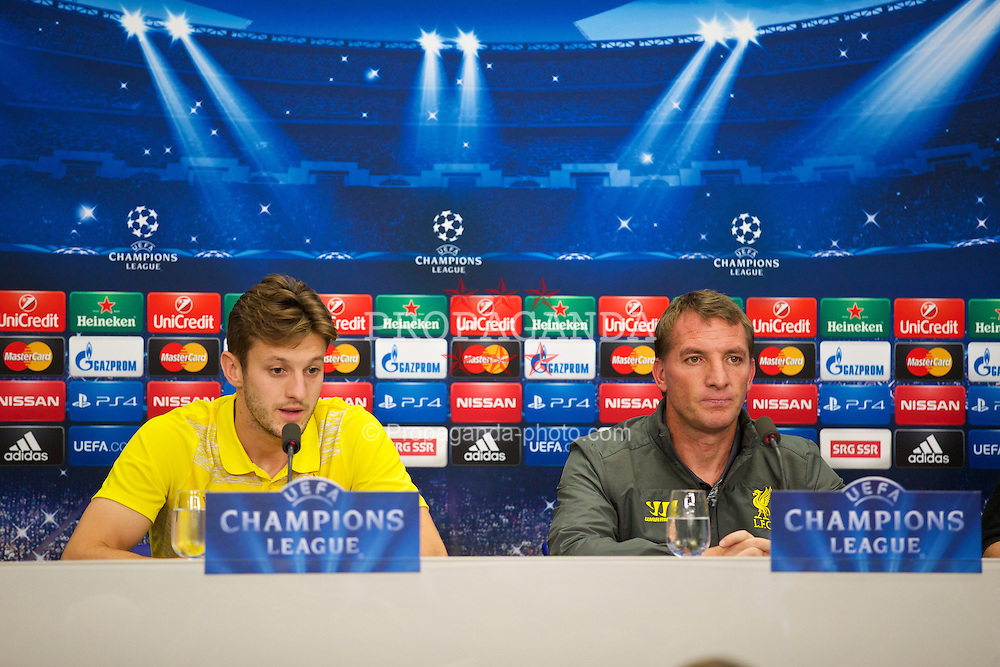 BASEL, SWITZERLAND - Tuesday, September 30, 2014: Liverpool's Adam Lallana and manager Brendan Rodgers during a press conference at the St. Jakob Stadium ahead of the UEFA Champions League Group B match against FC Basel. (Pic by David Rawcliffe/Propaganda)