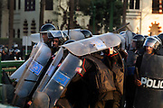 "Egyptian riot police shield themselves from thrown stones and bricks during a battle with thousands of protesters during January 25, 2011 ""Day of Anger"" demonstrations in downtown Cairo, Egypt. Today's protests across Egypt, inspired by the revolution in Tunisia, were organized by a wide range of opposition groups and intended to spark a similar movement in Egypt. Credit: Scott Nelson"