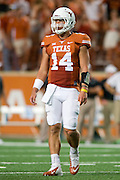 AUSTIN, TX - AUGUST 30:  David Ash #14 of the Texas Longhorns looks on against the North Texas Mean Green on August 30, 2014 at Darrell K Royal-Texas Memorial Stadium in Austin, Texas.  (Photo by Cooper Neill/Getty Images) *** Local Caption *** David Ash