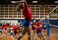 Brooke Beaudet goes up for a spike surrounded by her teammates during the Lakes Region Volleyball Jamboree Wednesday evening.  (Karen Bobotas/for the Laconia Daily Sun)