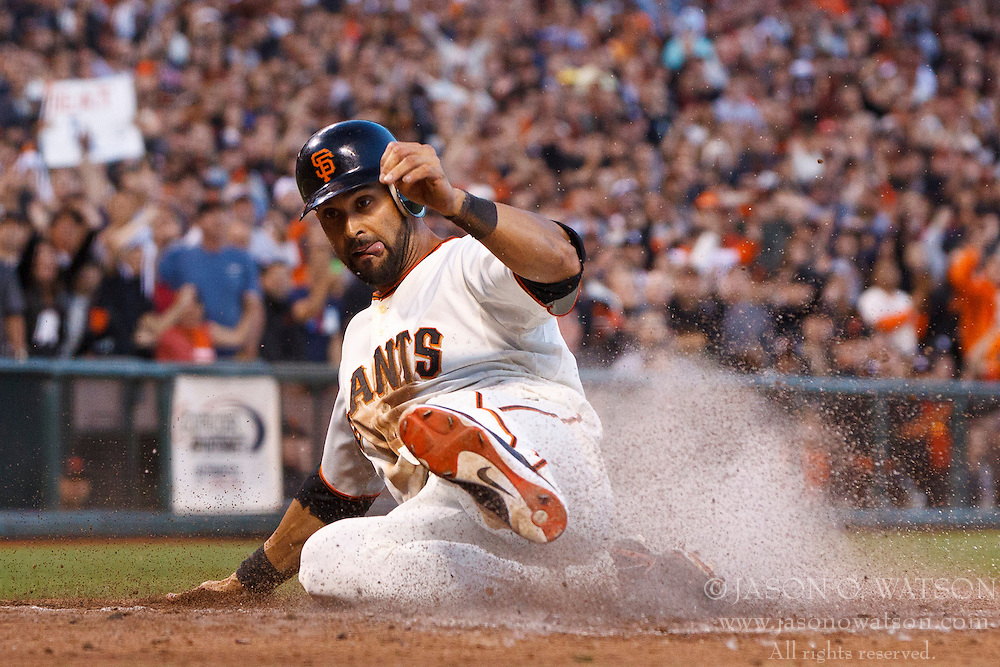 SAN FRANCISCO, CA - JUNE 26: Angel Pagan #16 of the San Francisco Giants slides into home plate to score a run against the Los Angeles Dodgers during the fourth inning at AT&T Park on June 26, 2012 in San Francisco, California. The San Francisco Giants defeated the Los Angeles Dodgers 2-0. (Photo by Jason O. Watson/Getty Images) *** Local Caption *** Angel Pagan