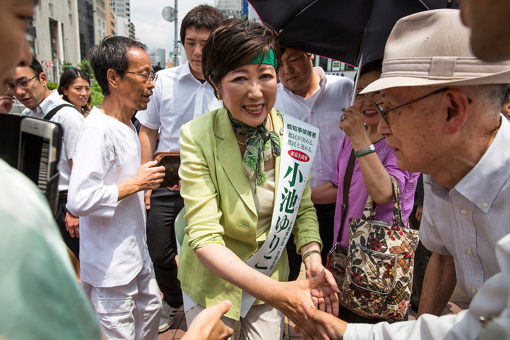 """TOKYO, JAPAN - JULY 20 : Yuriko Koike, a Liberal Democratic Party lawmaker and former defense minister greets people before she deliver her speech campaign for the July 31 Tokyo gubernatorial election in front of Gotanda Station in Tokyo, Japan on Wednesday, July 20, 2016. One of Yuriko's slogan for Tokyo is """"Women, men, children, senior, nor people with disabilities can have a lively life in the city of Tokyo and to be active"""".  (Photo by Richard Atrero de Guzman/NUR Photo)"""