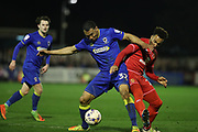 AFC Wimbledon defender Darius Charles (32) and MK Dons striker Nicky Maynard (28) battle for the ball during the EFL Sky Bet League 1 match between AFC Wimbledon and Milton Keynes Dons at the Cherry Red Records Stadium, Kingston, England on 14 March 2017.