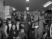 15/05/1982<br /> 05/15/1982<br /> 15 May 1982<br /> An Taoiseach, Mr Charles Haughey, canvasing with Fianna Fail bye-election candidate Eileen Lemass in Dublin West. Image shows An Taoiseach (centre) cutting the tape on a new extension in SPAR on Ballyfermot Road. Roscommon T.D. Terry Leyden on right, with Eileen Lemass visible between the two men.
