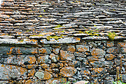 1800s stone barns at Lake Louvie in Pennine/Valais Alps, Switzerland, Europe.   The dramatic Chamois Path (Sentier des Chamois) starts at La Chaux ski lift in Verbier and ends at Fionnay PostBus. Cross Col Termin (2648m/8688 ft) in Haut Val de Bagnes nature reserve and descend to Lake Louvie via 1800s stone barns to the north, then to Fionnay, for a cumulation of 640 m up and 1415 m down in 8.5 hours.