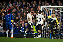 LONDON, ENGLAND - Saturday, December 4, 2010: Everton's goalkeeper Tim Howard looks dejected as Chelsea's Didier Drogba prepares to score the opening goal during the Premiership match at Stamford Bridge. (Pic by: David Rawcliffe/Propaganda)